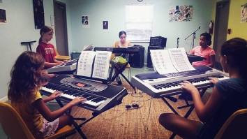 Keyboard lessons at Girls Rock Camp.