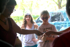 Sarah Hinds explains glass blowing during camp with the girls.